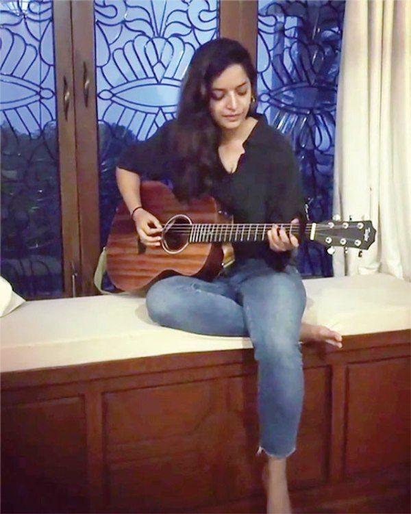 Lisa Mishra Playing Guitar