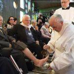 Pope Francis touching the feet of patients