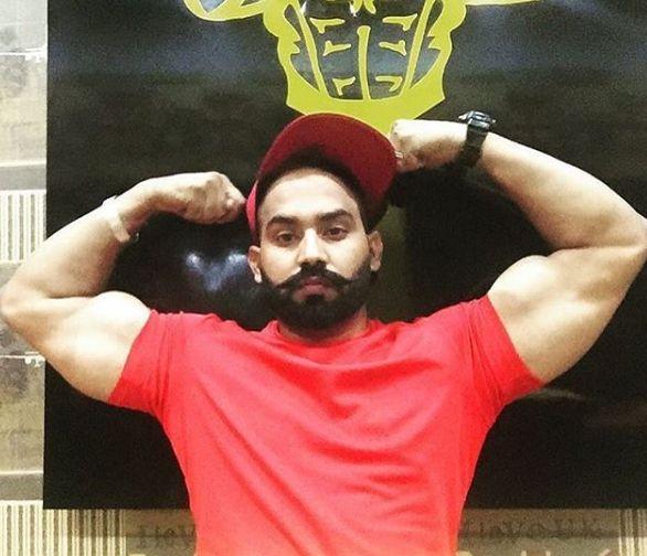 Sukh Sandhu showing his body at a gym