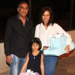 Milan Luthria with his wife and daughter