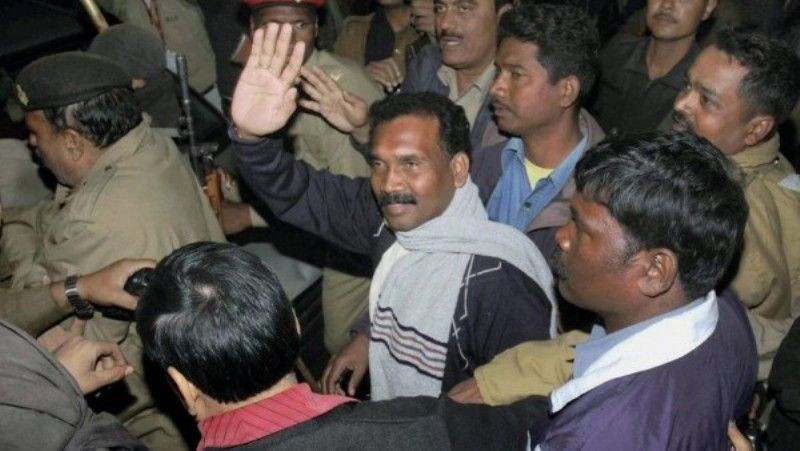 Madhu Koda after being arrested