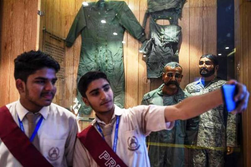 Students taking selfie with the mannequin of Abhinandan Varthaman in Pakistan