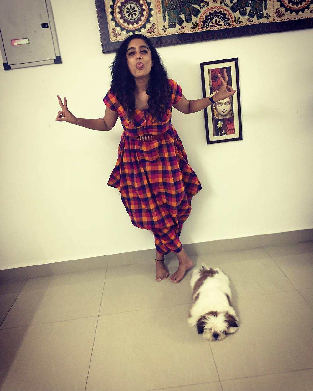Abhirami Venkatachalam Posing With Her pet Dig