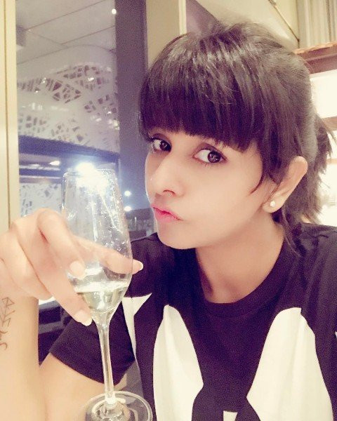Dalljiet Kaur with a glass of wine