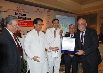 Ajit Singh presenting award to Sanjay Godhwani