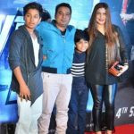 Ahmed Khan with his wife and sons