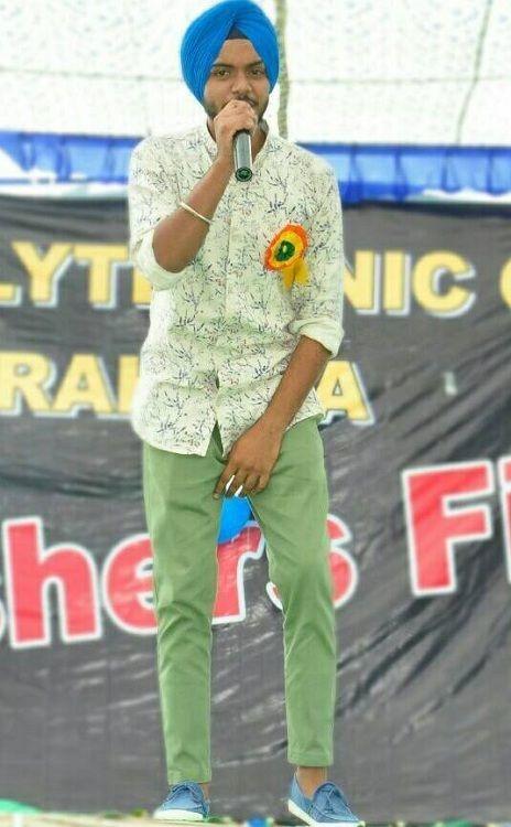 Satbir Aujla singing during his college function