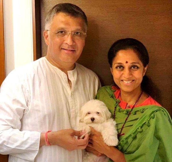 Supriya Sule with her husband Sadanand Sule and their dog Luka