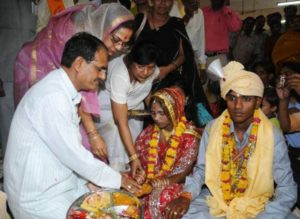 Sadhna Singh with her husband performing rituals during a mass marriage event