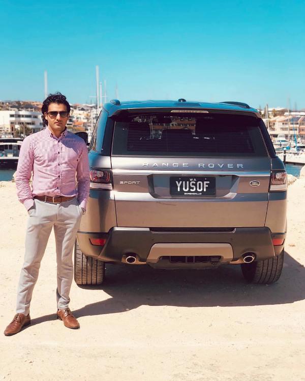Yusof Mutahar Posing with His Range Rover