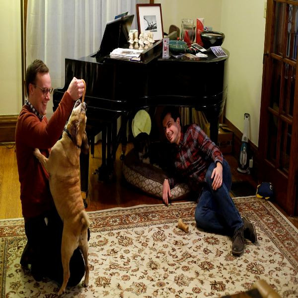 Pete Buttigieg And Chasten Glezman Playing With Their Dogs