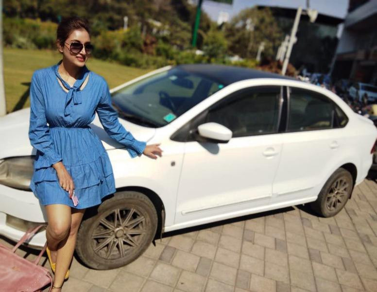 Rupali Bhosale Posing In Front Of Her Skoda Car