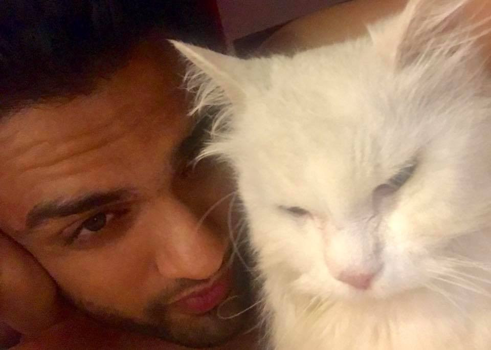 Rishaab Chauhaan with his cat