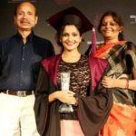 Samvedna Suwalka with her parents