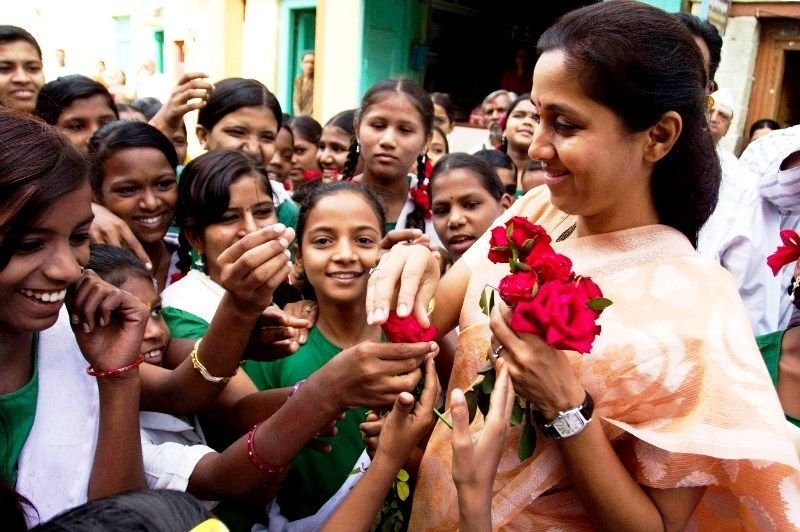 Supriya Sule being greeted by children before an awareness campaign on female foeticide