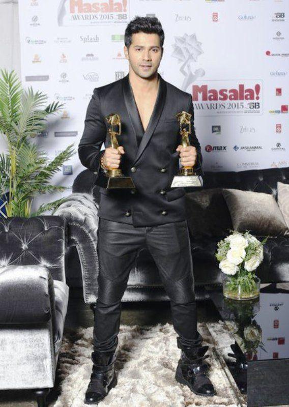 Varun Dhawan Posing With His Awards