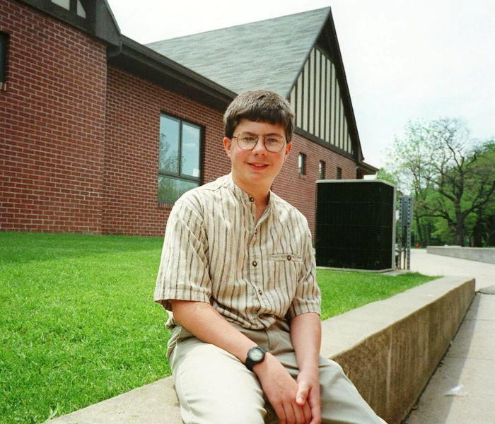 Pete Buttigieg Sitting In Front Of Stanley Clark School