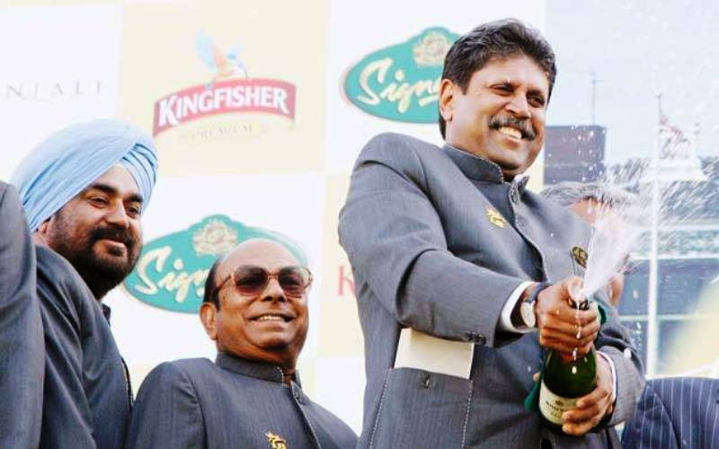 Kapil Dev Celebrating With A Bottle Of Champagne