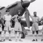 Arjan Singh as a flight lieutenant with pilots from No1 Squadron standing by a Hawker Hurricane
