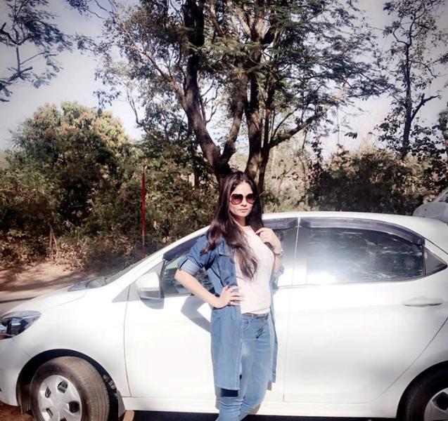 Aabha Paul Posing with Her Car