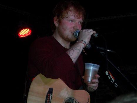 Ed chug beer