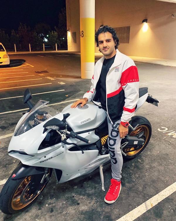 Yusof Mutahar Posing with His Motorcycle