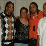Jey and Jimmy Uso with their mother Talisua Fuavai Fatu and brothers