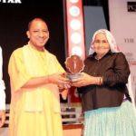 Chandro Tomar receiving Devi Award from CM Adityanath Yogi