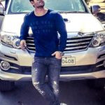 Shoaib Ibrahim poses with his Toyota Fortuner car