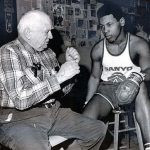 Mike Tyson with his trainer in 1980
