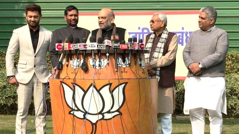 Chirag Paswan (extreme left) with Ram Vilas Paswan (left), Amit Shah (centre) and Nitish Kumar (right) announcing LJP & BJP's alliance