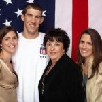 Michael Phelps with his mother and two sisters