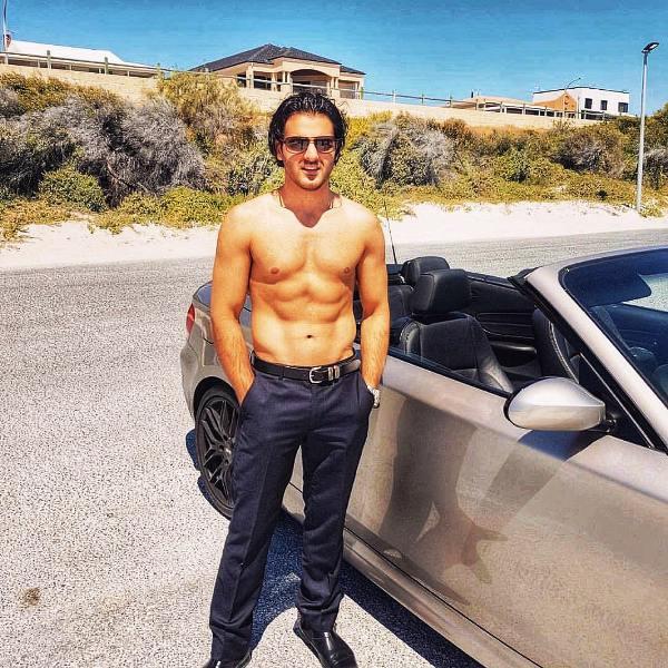Yusof Mutahar Posing with His Car