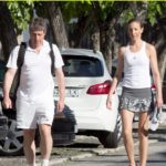 Anna Eberstein playing tennis with Hugh Grant