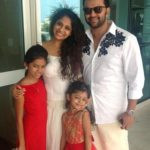 Poornima with her husband and daughters