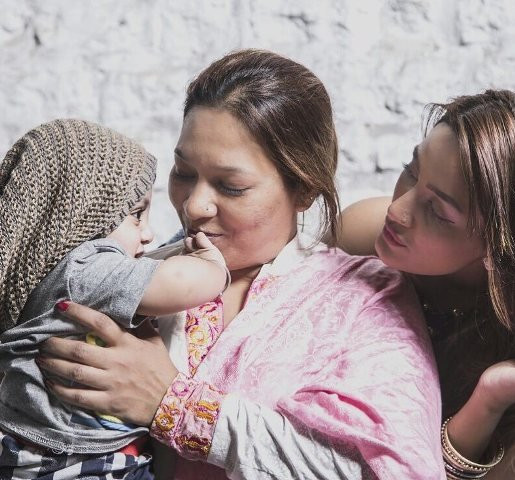 Mathira with her mother and son