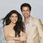 Rahul Sharma with his wife Asin