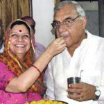 Bhupinder Singh Hooda with his wife