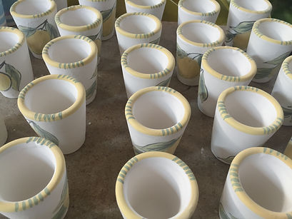 Limoncello shot glasses waiting to be baked in the high-firedoven