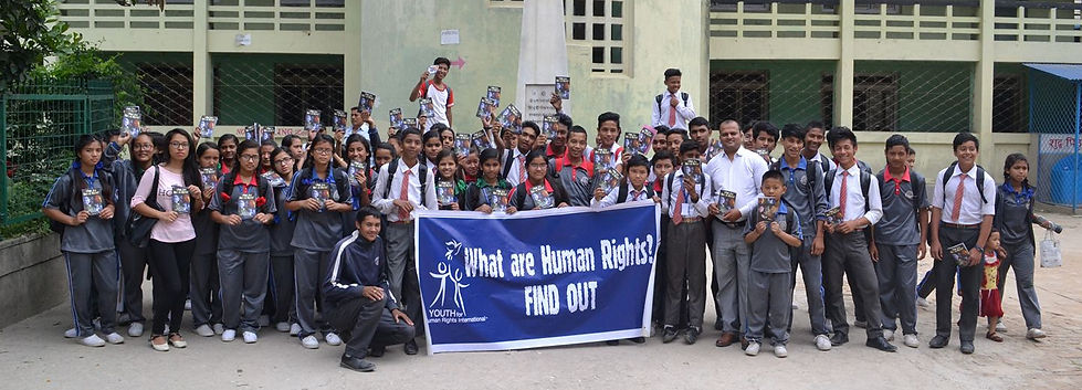 School students with Human Rights Booklets; A group photo.