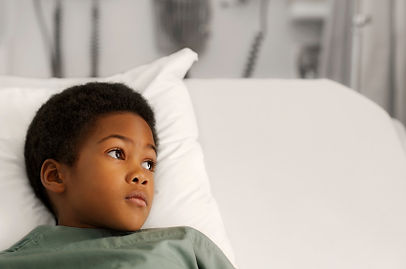 Kids for Life boy in hospital bed