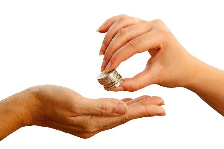 womans_hand_passing_stack_of_coins_to_another_han_450.jpg