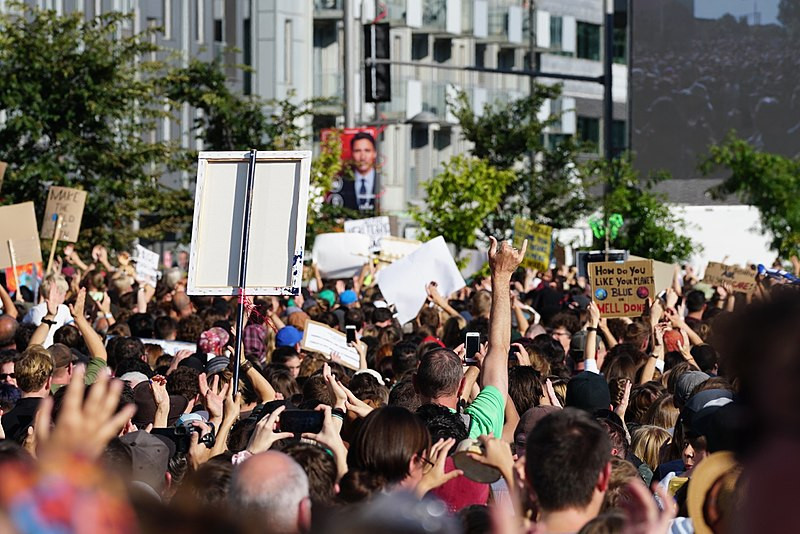Protestors march with signs as part of the Montreal Climate March on September 27, 2019.
