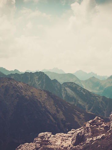 Woman hiker on a top of a mountain .jpg