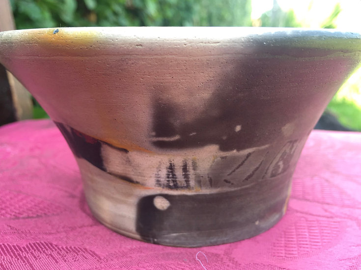 Pit Fired bowl 15. 11x8cm