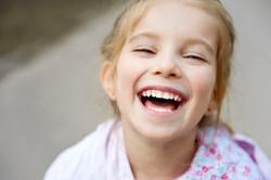 seu filho com dentes saudáveis