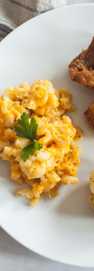 Amp up your event with one of our signiture dishes - Pictured we have Macaroni and Cheese, Seasoned Fried Chicken, Loaded Twice Baked Potatoes