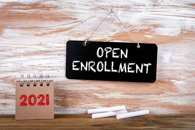 OPEN ENROLLMENT. Small chalk board and w