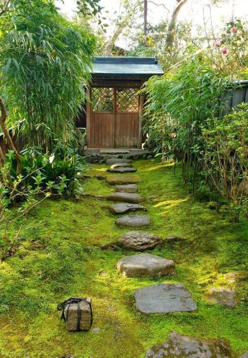 A rock pathway surrounded by moss, in the garden at Honen-in temple.