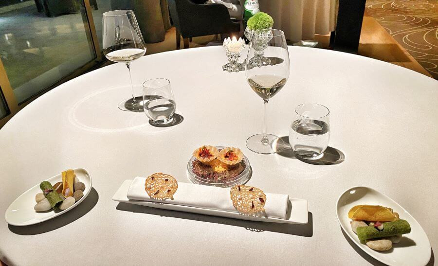 Table setting with amuses-bouches at Gusto by Heinz Beck, Portugal